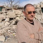 Dr. Meir Margalit in front of demolished Arab housing.  For opposing these demolitions and supporting the rights of Arabs to build homes on the same basis as Jews, he was recently interrogated by Israeli authorities on orders of the Housing Minister and may be criinally charged