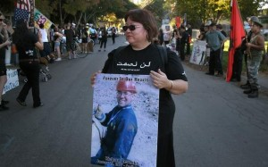 Adrianne DeSantis, the mother of Richard DeSantis, carrying a poster of her son during a demonstration. (The Press Democrat, 2007)